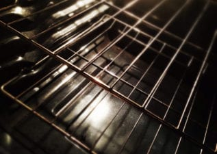 clean oven racks and bottom