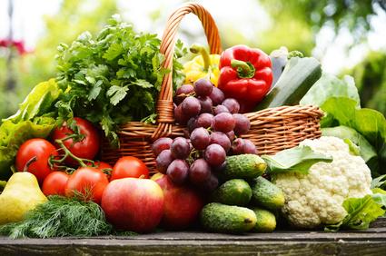 Fresh organic vegetables in wicker basket in the garden