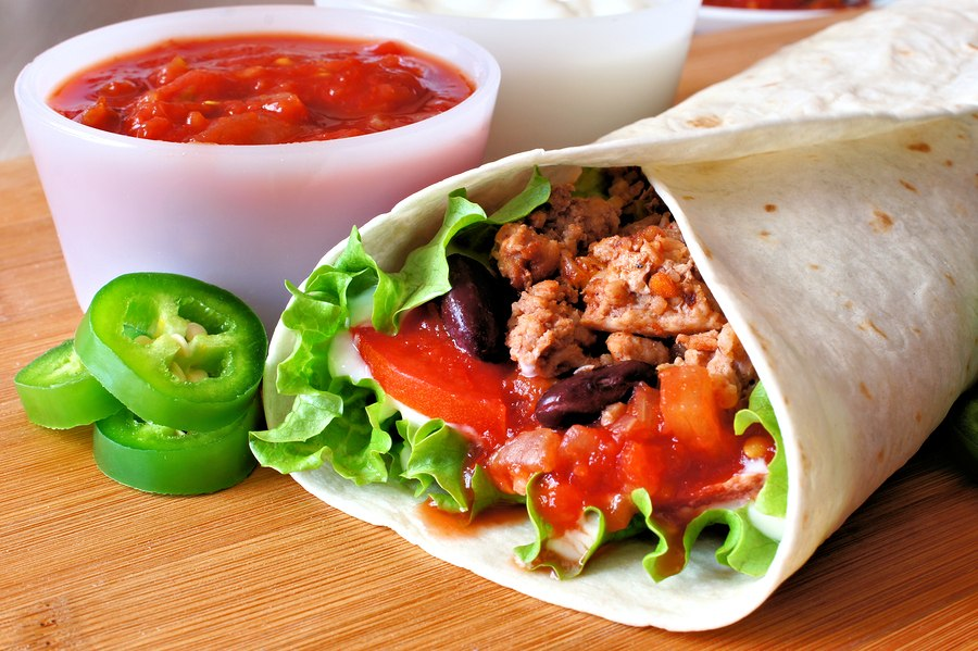 Burrito with salsa and peppers