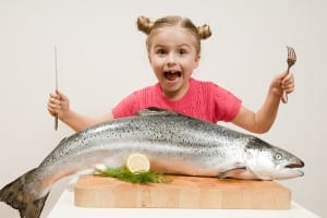 Little-girl-and-big-fresh-fish-16369082[1]